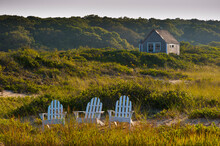 Adirondack Chairs On Lawn At Martha's Vineyard Near Beach With Small Shack In Background