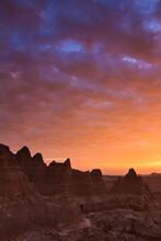 Clouds Reflect Color Over Badlands National Park, South Dakota At Sunrise.