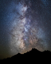 The Milky Way Descends Over The Watchman, At The Edge Of Crater Lake (Crater Lake National Park), Oregon.