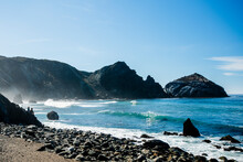 Waves Roll Ashore On The Dramatic, Rocky Coast Of The Willow Creek Picnic Area In Big Sur, CA.