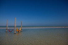 Red And Yellow Hammocks In The Waters Of The Gulf Of Mexico On Holbox Island, Mexico.