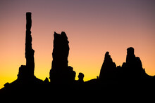 A Silhouette Of Monument Valley's Totem Pole And Surrounding Sandstone Towers.