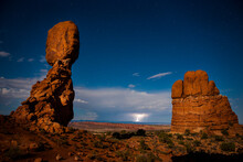 A Midnight Storm. An Almost Full Moon Lit Up Balanced Rock In Arches National Park.
