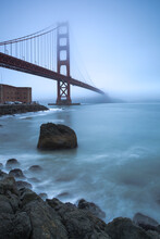A Mysterious And Foggy Morning At The Golden Gate Bridge In The Early Morning Light.