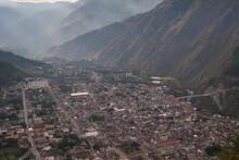 The City Of Banos, Ecuador Sprawls At The Base Of Active Volcano Tungurahua.