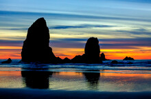 Cannon Beach, Oregon: A Fall Sunset At The Needles Sea Stacks.