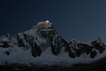 Sunset And The Last Sliver Of Light Upon Mt. Tralliraju In The Cordillera Blanca In The Andes Mountains Of Peru.