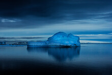 A Large Iceberg Slowly Drifts In The Bay In Antarctica.