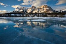 Sunset On High Alpine Peaks Above The Frozen North Saskatchewan River In Banff National Park.