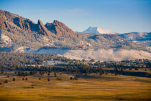 The Flat Irons Rock Escarpments Rise Above Boulder, Colorado And The Snow-covered Summit Of Mt. Long's Peak Are Seen Further North In Early Spring.