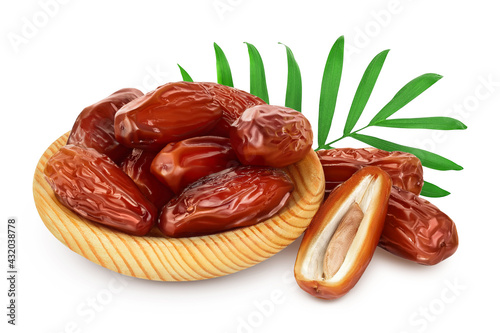 Fototapeta Dates in wooden bowl isolated on white background with clipping path and full depth of field. obraz