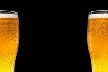 Two Beer Glasses On A Black Background. Space For Text And Logo
