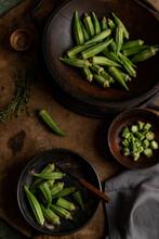 Okra In Wood Bowl