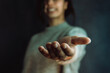 Woman giving hands to the camera, help and self help concept, mental health