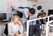Leinwandbild Motiv Male angry boss blaming adult female office worker in office