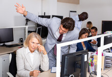 Male Angry Boss Blaming Adult Female Office Worker In Office