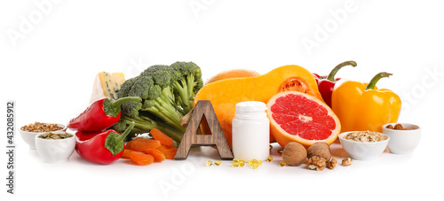 Fototapeta Healthy products rich in vitamin A on white background obraz