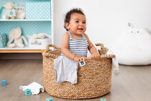 Happy Baby Playing In Laundry Basket