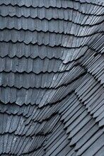 Shingles On The Roof. Wooden Roof, Shingled Roof. Wooden Tile. Roof Of Complex Construction With Dormer Windows