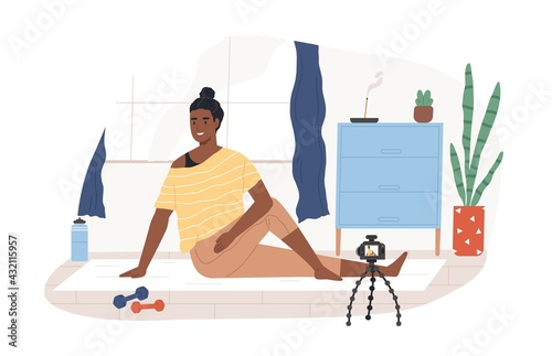 Fototapeta Fitness blogger on yoga mat recording online video classes of sports exercises. Black-skinned vlogger in front of camera on tripod. Colored flat vector illustration isolated on white background obraz