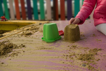 Children's Toys For Playing With Sand Lie In The Sandbox On The Playground In Sunny Weather