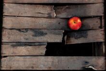 Wooden Broken Box. One Apple. Wallpapper. Text Area.