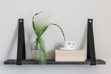Minimalistic Shelf With Plant On It