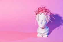 Trendy Venus Plaster Head Planter With Paper Brain On Pink Background