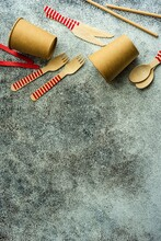 Overhead View Of Eco Recyclable Cutlery And Cups On A Table