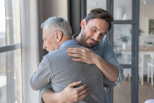 Caring Cute Caucasian Adult Son Hugging Embracing His Old Elderly Senior Father Showing Him Love And Support. Family Time, Happy Father`s Day! I Love You, Dad!