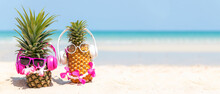 Summer In The Party.  Hipster Pineapple Fashion In Sunglass And Listen Music On The Sand Beach Beautiful Blue Sky Background.  Creative Art Fruit For Tropical Style.   Copy Space For Banner