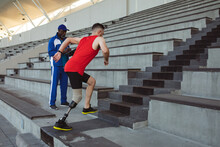 Caucasian Male Athlete With Prosthetic Leg Climbing On The Stairs Of The Stadium