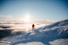 Skier Skiing In Ski Resort In Winter