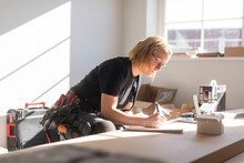 Woman Drawing Plan During House Renovation