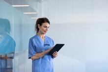 Female Nurse Using Tablet
