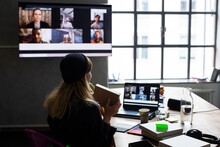 Businesswoman Showing Product To Customers Over Web Conference In Board Room At Office