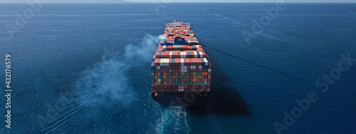 Obraz na plátně Aerial drone ultra wide photo above huge colourful container carrier vessel crui