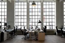 Interior Of Creative Office With Desks And Chair