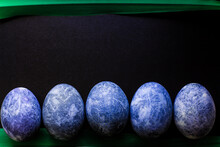Blue Easter Eggs Painted In Hibiscus With Natural Dye On A Black Background With A Dark Green Leaf With A Place For An Inscription