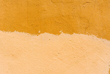 Painted In A Yellow Rough Orange Wall. Close Up View