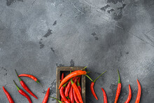 Chili Spur Pepper , In Wooden Box, On Gray Stone Background, Top View Flat Lay, With Copy Space For Text