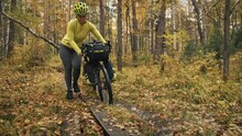 The Woman Travel On Mixed Terrain Cycle Touring With Bikepacking. The Traveler Journey With Bicycle Bags. Sport Tourism Bikepacking.