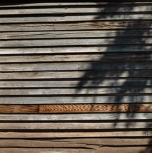 Old Wooden Wall With Shadow Alomogordo New Mexico USA. Worn Out Wooden Shelves