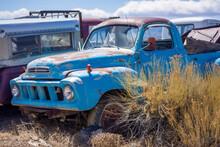 Blue Truck In A Junkyard