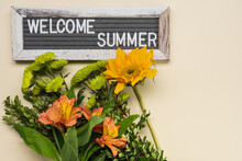 Bouquet With Alstroemeria, Mini Green Chrysanthemums And A Small Yellow Sunflower On A Pale Yellow Background With Welcome Summer Felt Board Sign