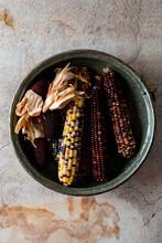 Multi Colored Corn In Metal Bowl