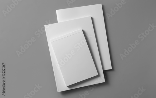 Brochures with blank covers on light grey background, top view - fototapety na wymiar