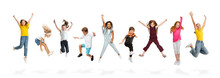 Group Of Elementary School Kids Or Pupils Jumping In Colorful Casual Clothes On White Studio Background. Creative Collage.
