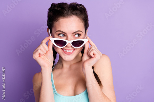 Fotografie, Obraz Close-up portrait of attractive cheerful girlish girl touching specs looking iso