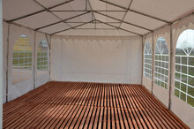 A Large Plastic Tent Used As A Temporary Shelter For Entertaining Guests At Weddings And Concerts And Parties. Party Or Coronavirus Testing Is Not Possible Without Temporary And Washable Shelters